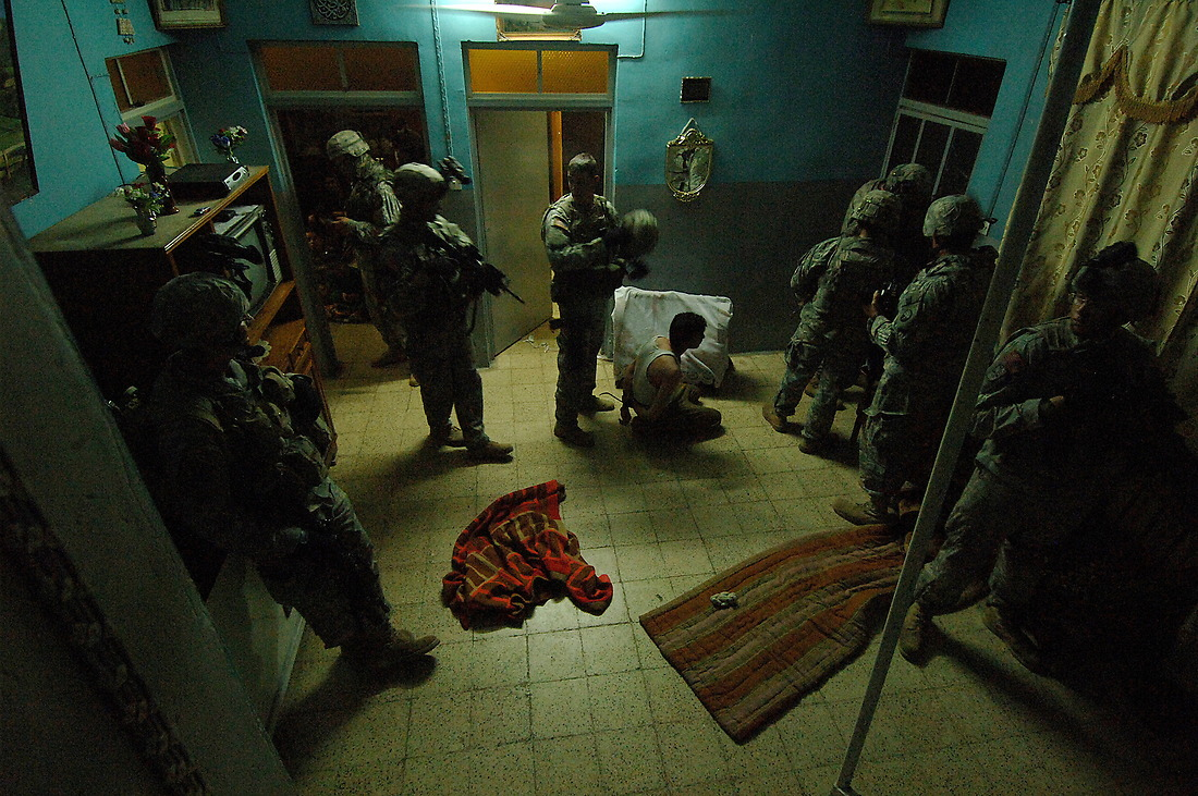 Soldiers from Bravo Company 1/17th Infantry 172nd Stryker BDE Ft. Wainwright, Alaska, conduct an early morning cordon search of a house on May 26, 2006 in the North West neighborhood of Al Nijar, Mosul, Iraq. Nine Iraqi's were detained in the searches, all suspected of terrorist activity as IED facilitators and enablers. — © TSgt Jeremy Lock/
