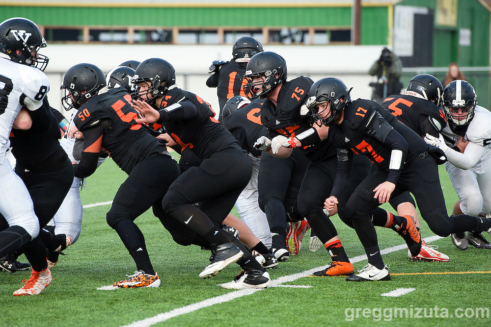 5Scio's offensive line (L to R: Dillon Wallen, Nathan Yoder, Taylor Lowther, Malcolm Robinson) attempts to create running space against Vale in the 3A semifinal playoff game at Kennison Field, Hermiston, Oregon, Saturday, November 21, 2015. Vale won 42-14.