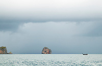Long tail boat under a cloudy sky on the Andaman Sea Thailand&amp;#xA;<br />