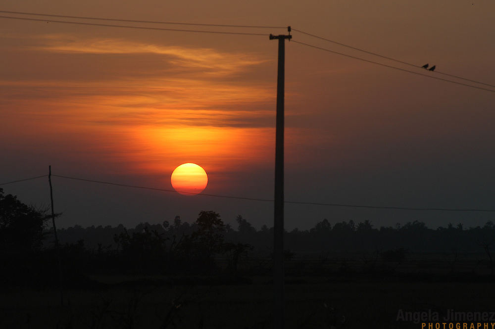 The sun sets over the fishing village of Perumalpettai, in Tamil Nadu, India on January 19, 2005, after the area was struck by the Indian Ocean Tsunami on December 26, 2004, killing 37 of the villagers and destroying nearly all of their fishing boats. Generated by an earthquake on the ocean floor, the tsunami devastated the fishing industry along the southeastern coast of India.