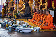Breakfast is presented to monks at the local temple as a way of giving alms to make merit. The monks will bless the food and will eat first, then the meal will become potluck for the congregation to enjoy on the first day of Songkran, Nakhon Nayok, Thailand, April 13, 2017. PHOTO BY LEE CRAKER