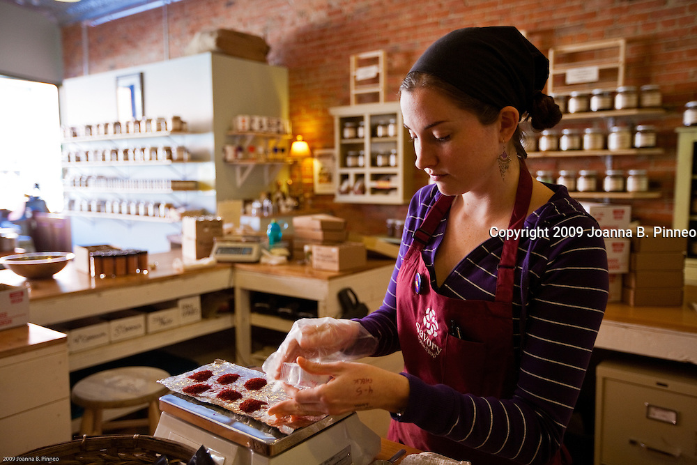 Savory Spice Shop, Boulder, Colorado. Leila Mcfadden fills bags with Spanish Coupe Saffron.