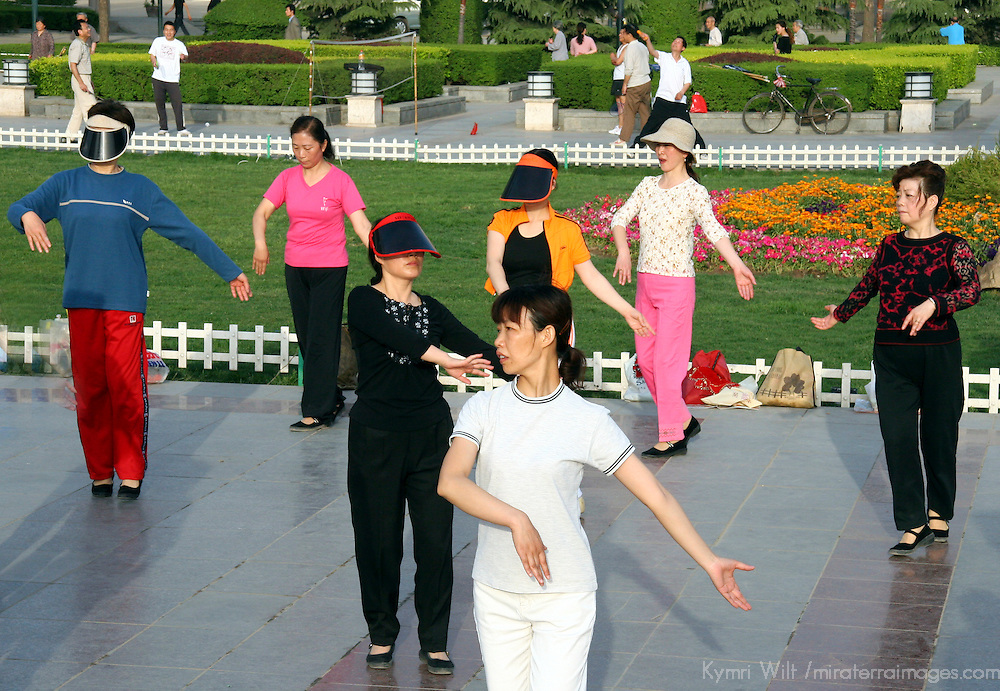 Asia, China, Shaanxi, Xian. Early morning routine of Tai Chi in the park at Renman Square in Xian.