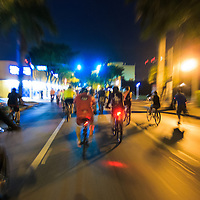 Cyclists in the March 28, 2014 Miami Critical Mass ride travel east on Calle Ocho (SW 8th Street) after dark.