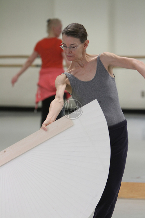 """Choreographer and Dancer, Molissa Fenley, working with Seattle Dance Project dancers on """"Planes In Air""""."""