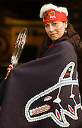 Wilma Leslie, native Alaskan woman of Tlingit and Haida ancestry, wearing traditional Tlingit regalia, at Chief Shakes Island House; Wrangell, Alaska.