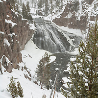 Gibbon Falls in late fall during a heavy snow