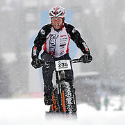 SHOT 2/9/13 5:12:54 PM - Jake Wells of Avon, Co. climbs uphill during the On-Snow Mountain Bike Crit event at the second annual Winter Mountain Games presented by Eddie Bauer at Vail Ski Resort in Vail, Co. Wells won the Fat Tire Male class. The Winter Mountain Games feature competitions in X-Country On-Snow Mountain Bike Races, mixed climbing, Telemark Big Air,Best Trick Bike and On-Snow Mountain Bike Crit with more than$60,000 in prize money on the line. (Photo by Marc Piscotty / © 2013)