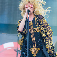 LAS VEGAS - SEP 20: Singer Taylor Momsen of The Pretty Reckless performs on stage at the 2014 iHeartRadio Music Festival Village on September 20, 2014 in Las Vegas.