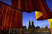 The twin-towers of the El Dorado at 300 Central Park West stand above the Lake in Central Park surrounded by The Gates installation. Years in conception and making, The Gates, Central Park, New York City, 1979-2005,  by Christo and Jeanne-Claude, made a brief appearance in February 2005.