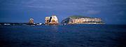 ECUADOR, GALAPAGOS sea arch off cliffs of Darwin Island