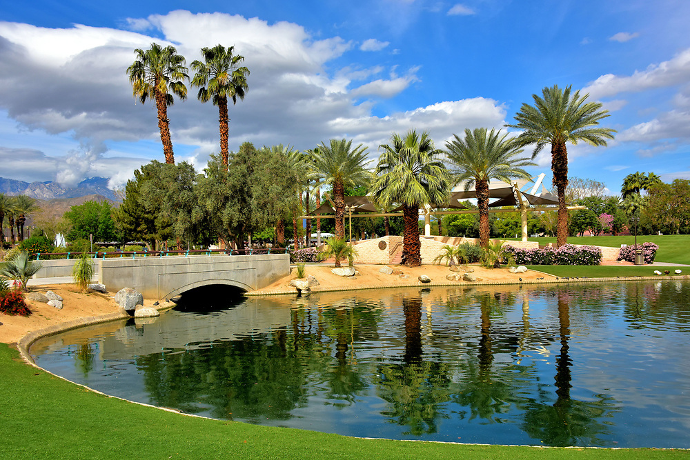 Lakeside Amphitheater at Civic Center Park in Palm Desert, California<br /> The Palm Desert Civic Center Park is incredible! The 70 acres of this immaculate greenspace offers fun and relaxation for everyone. Stroll around the walking paths to enjoy the scenery, ponds, outdoor art and a date grove. Young kids favor Playland and Tot Lot. Teenagers gravitate to the skateboard courses. Families laugh together at the picnic pavilions and splash together at the Aquatics Center. Athletes compete on the basketball, volleyball and tennis courts or the softball fields.