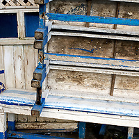 Blue benches lay stacked up during the day at the fish market in Essaouira, Morocco.  Come evening time they'll be set up for a new round of eating.
