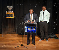 Tony Alford presents the Count on Me award to Theo Riddick..