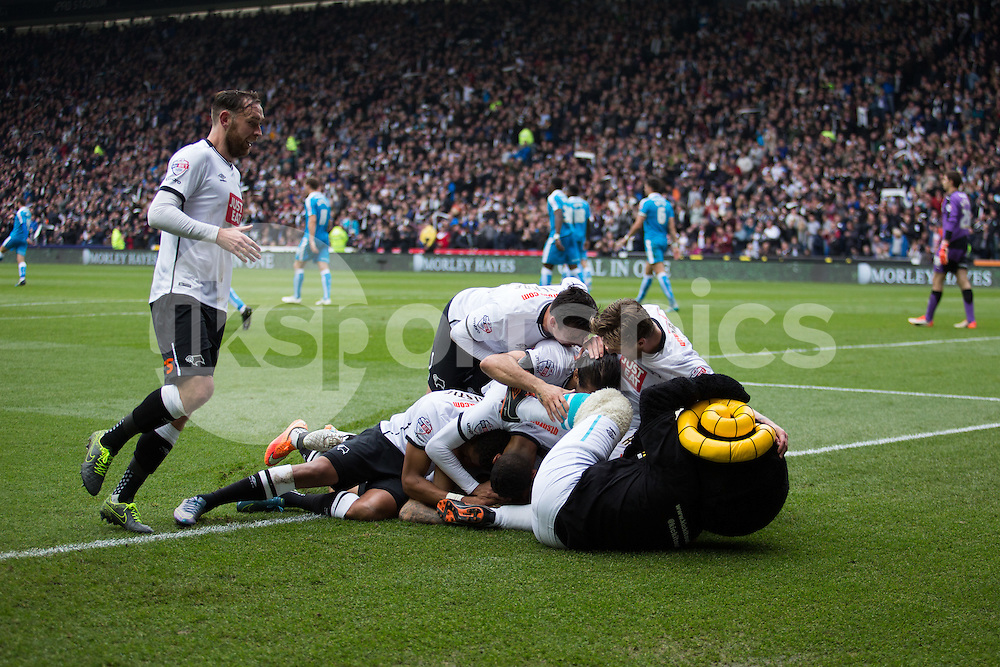 Johnny Russell of Derby County is mobbed by teammates and mascot! after scoring derby's fourth goal during the Sky Bet Championship match between Derby County and Wolverhampton Wanderers at the Ipro Stadium, Derby, England on 18 October 2015. Photo by James Williamson.