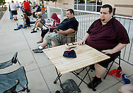 """Aaron Donoho (L) and Tony Carloni (R) wait in line at an open casting call for season 11 of """"The Biggest Loser"""" television show in Broomfield, Colorado July 17, 2010.  Over 600 people applied for a chance to be on the show and win $250,000.  REUTERS/Rick Wilking (UNITED STATES)"""