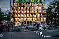 Foreign women in cosplay costume in front of paper lanterns painted with the names of sponsors of the o-hanami (flower viewing) festival in Ueno Park.  Tokyo, Japan.