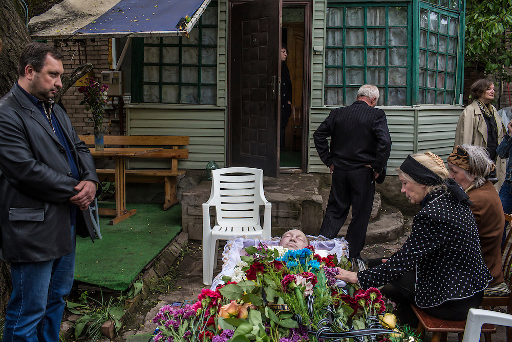 Relatives of Alexey Vorobyov mourn over his body on May 12, 2014 in Mariupol, Ukraine. Vorobyov was a bystander when he was killed by a bullet during clashes at a local police station on May 9, with tensions heightened by the Victory Day holiday and a referendum on greater autonomy for the region arranged by pro-Russia activists.