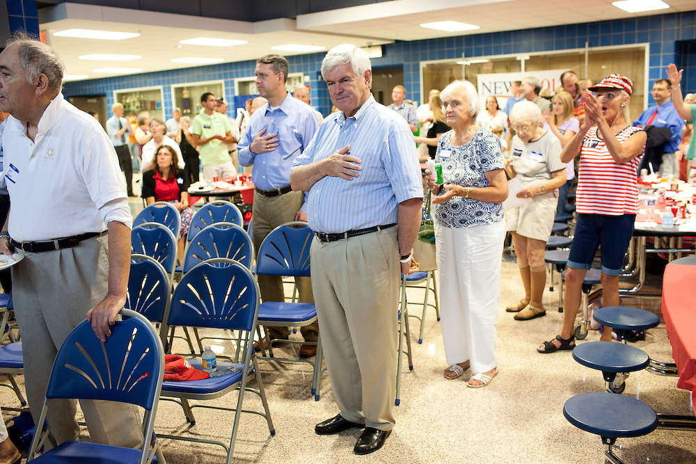 Republican presidential hopeful Newt Gingrich says the pledge of allegiance at the start of a fundraiser for the Linn County Republican party on Friday, August 5, 2011 in Tiffen, IA.