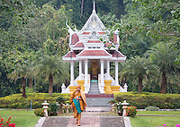 Buddhist monk in front of a temple, Wat Tham Pha Plong monastery, Chiang Dao,  Thailand