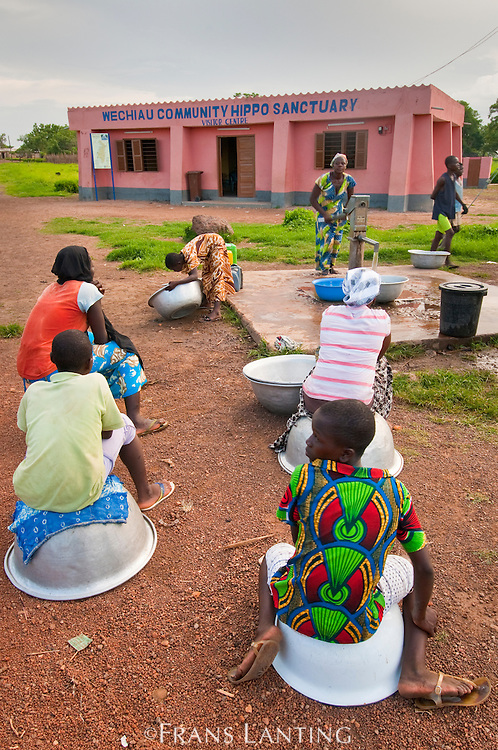 Women drawing water from well at visitor center for Wechiau Hippo Sanctuary, Wechiau, Ghana
