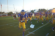 Oxford High's Harland Stewart (8) runs onto the field vs. Jackson Prep in Oxford, Miss. on Friday, August 23, 2013. Oxford won 32-20.