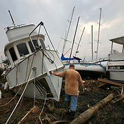 "Greg Berwick of Beaumont is emotional as he removes personal items from his boat ""Reverie"" at Pleasure Island Marina in Port Arthur, Texas, Thursday September 18, 2008.  He and his wife had gotten the boat, a Pilgrim 40, as a retirement dream.  Berwick doesn't know if the boat is salvageable, but the only nearby place at which a boat so large can be repaired is Kemah, a port town that also suffered major damage from Hurricane Ike."