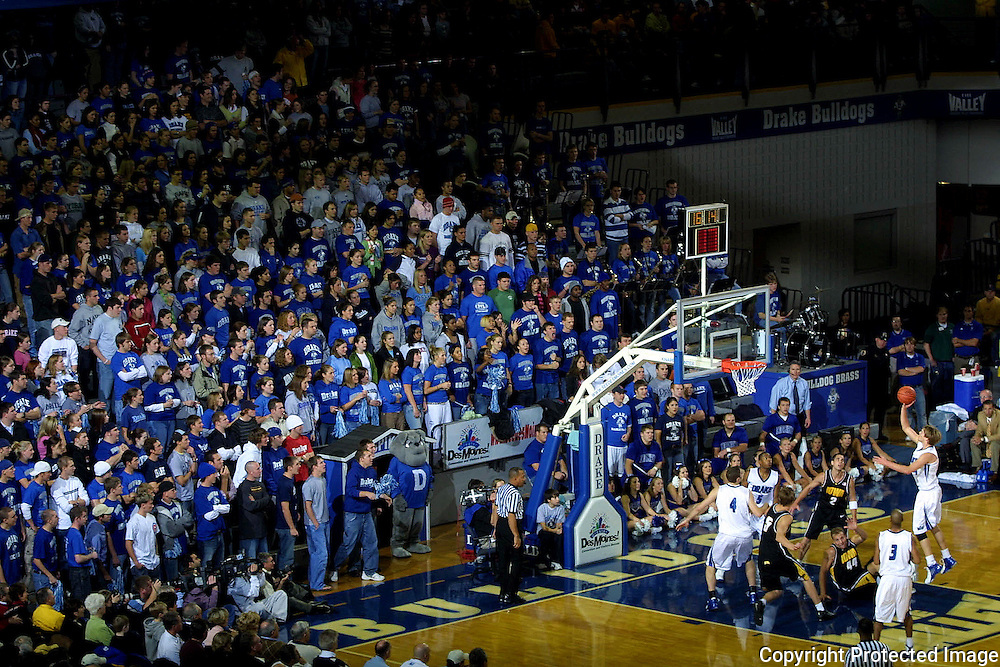 """The Drake student section, """"The Dog Pound"""", support the Bulldogs in their annual rivalry game with the University of Iowa.  photo by david peterson"""