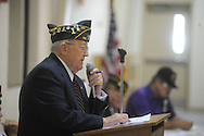 Will St. Amand reads the names of veterans who have died during he past year during a Memorial Day service at the National Guard Armory in Oxford, Miss. on Monday, May 31, 2010.