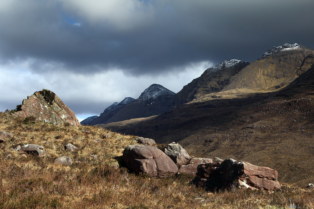 Rocks seen on the descent from Beinn Alligin. The mountain in the background is Liathach, another munro in the area around Loch Torridon in the Scottish Highlands.