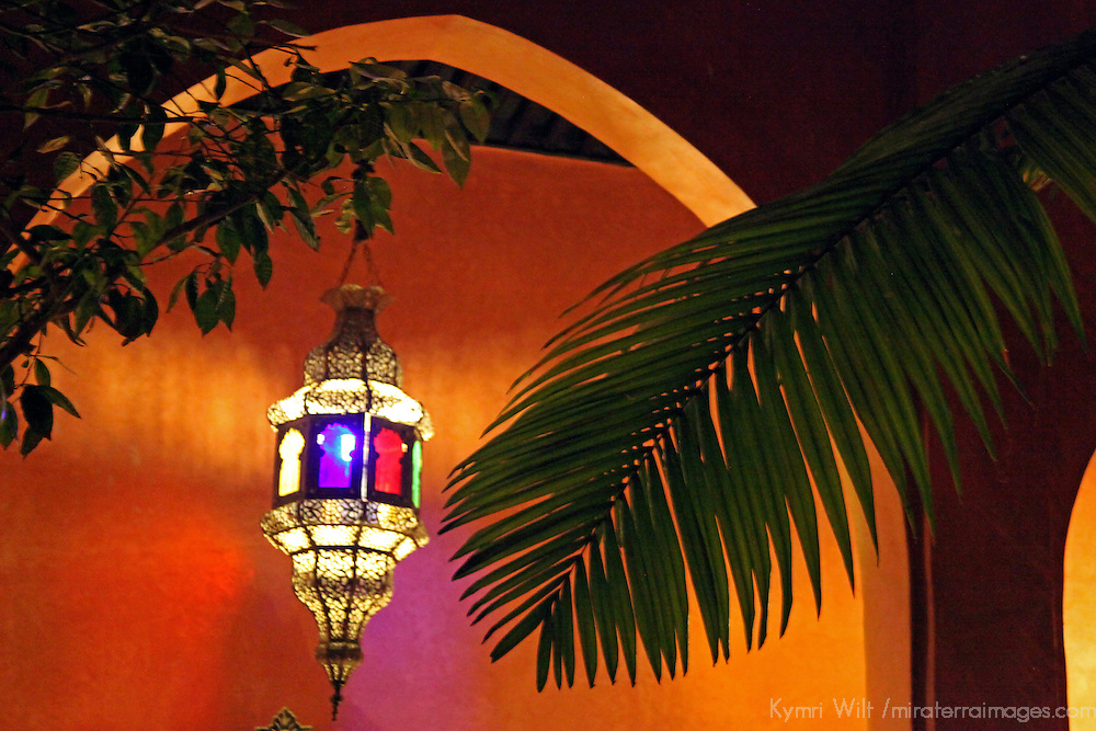 Africa, Morocco, Fes. Colorful lamp lights archway of outdoor courtyard in Fes.
