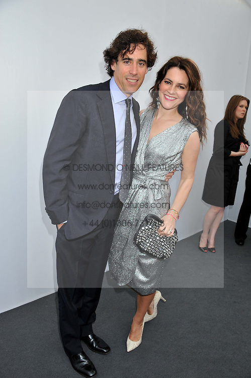 STEPHEN MANGAN and LOUISE DELAMERE at the Glamour Women of the Year Awards 2012 in association with Pandora held in Berkeley Square Gardens, London W1 on 29th May 2012.