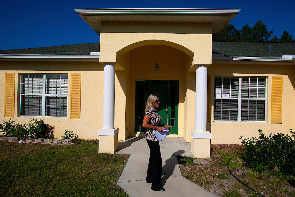TAMPA, FL -- March 22, 2011 -- Shannon Moore, broker/owner of Green Lion Realty, walks into a vacant home in North Port, Fla., 2011.  A recent study showed that one and five homes in the state of Florida is vacant.