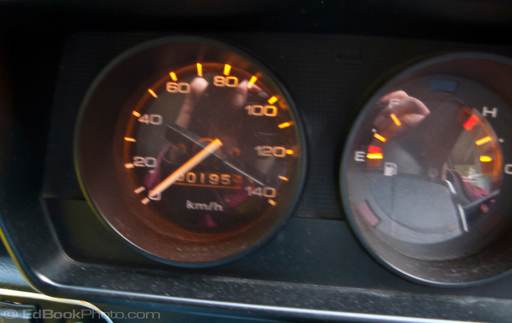 scene along a cross country trip with in a classic Mini Cooper auto - end of rough cross country drive in the classic Mini Cooper automobile odometer final reading