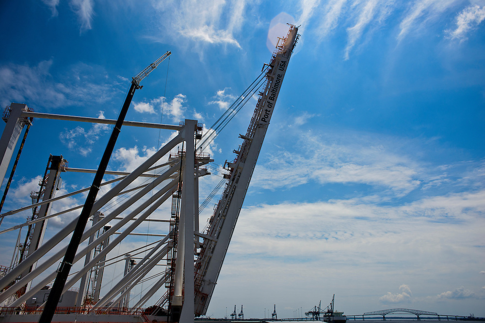 (photo by Matt Roth).Wednesday, July 11, 2012.Assignment ID: 30128574A..Four super-post Panamax cranes -- the largest model built -- are being erected at The Port of Baltimore's Seagirt Marine Terminal Wednesday, July 11, 2012. When fully extended, the super cranes will extend to a height of 40 storeys. ..Once the building, testing and training is finished, the Seagirt terminal will join Norfolk, VA as one of the only two ports on the East Coast which can unload new Panamax sized container ships. The cranes are expected to be fully operational in September of this year.