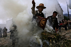A picture made available on 19 September 2016 of Tibetan pilgrims making incense offerings on a bonfire outside the Sera Monastery in Lhasa, Tibet Autonomous Region, China, 11 September 2016. Sera Monastery is  known as one of the 'great three' Gelug university monasteries of Tibet founded in 1419.