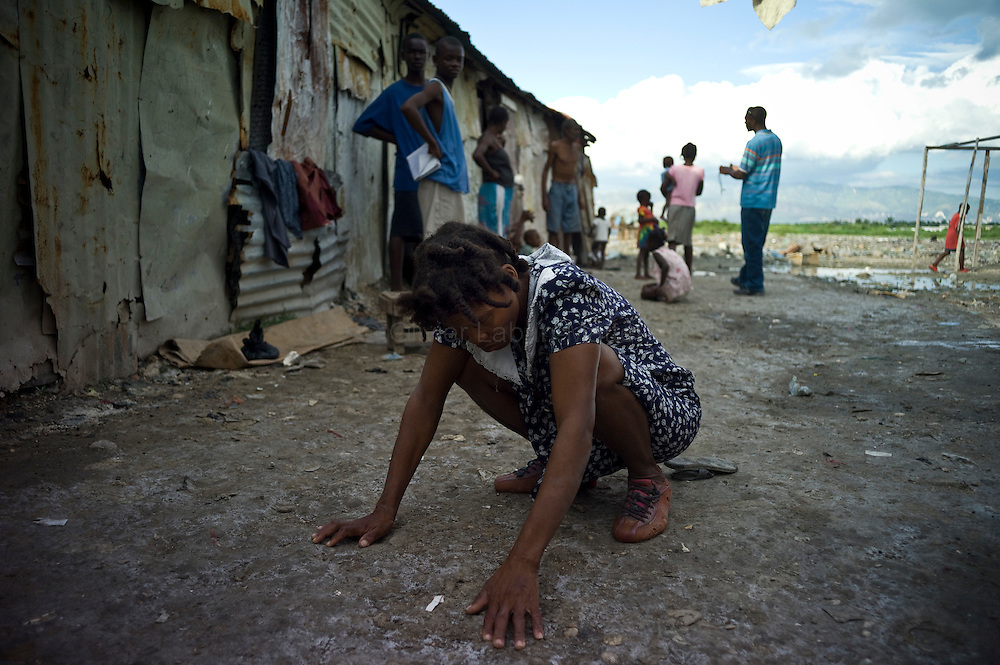 The number of cholera victims in Cité Soleil, a slum of Port-au Prince, is increasing day by day exponentially, according to a doctor of Doctors Without Borders.///Kernilis St John suffers from cholera, in front of her house located in the slum of Cite Soleil in Port-au-Prince.