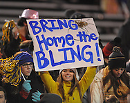 Isabella Moak holds a sign at Oxford High vs. Picayune in the MHSAA Class 5A championship game at Mississippi Veterans Memorial Stadium in Jackson, Miss. on Saturday, December 7, 2013.
