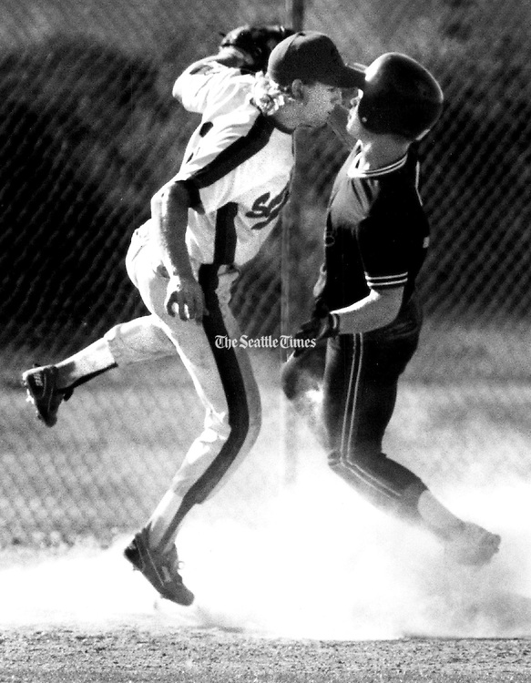 A South End Heating third baseman tags out a Shelton Logger. (Tom Reese / The Seattle Times, 1980)