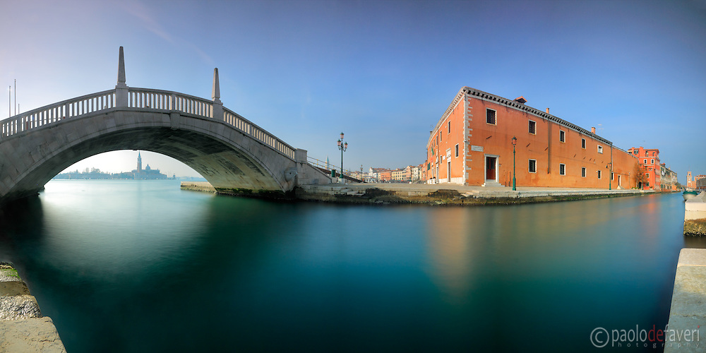 """A panoramic view at noon of the Arsenale Canal (Rio dell'Arsenale), with the Forni Militari palace and the Arsenale gate in the background. This is stitched from nine vertical frames, each of them exposed for 30"""""""