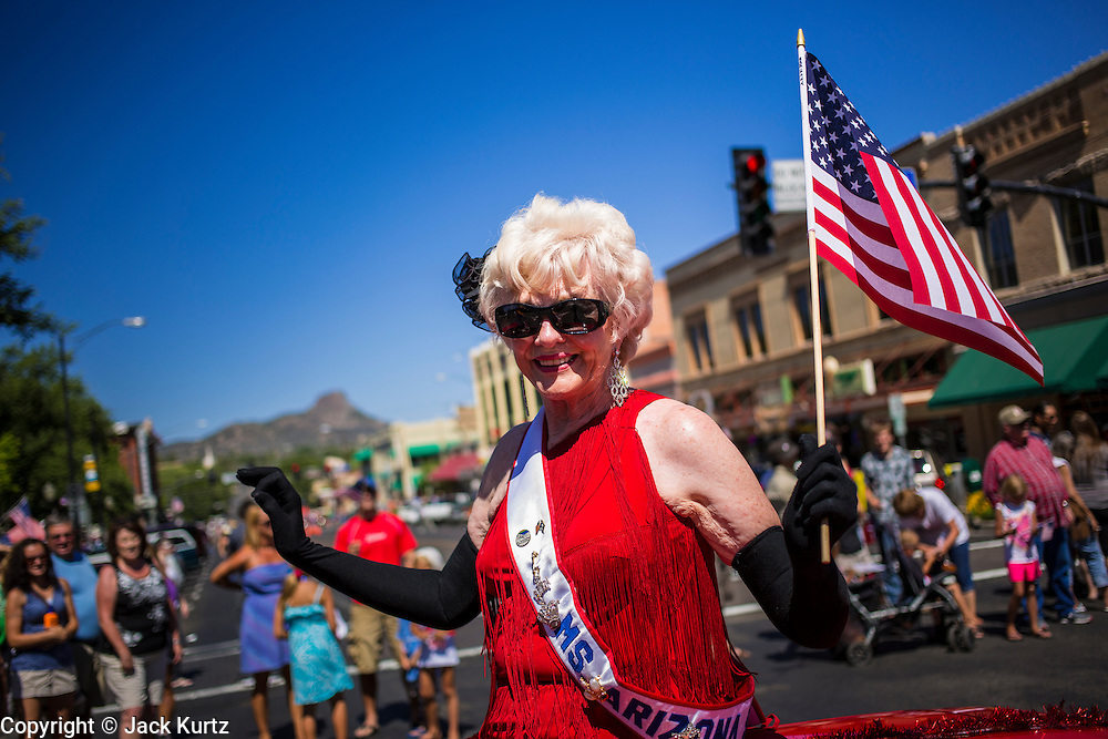 30 JUNE 2012 - PRESCOTT, AZ:  JAN RITTMASTER, Ms. Senior Arizona from 1998, waves to the crowd at the Prescott Frontier Days Rodeo Parade. The parade is marking its 125th year. It is one of the largest 4th of July Parades in Arizona. Prescott, about 100 miles north of Phoenix, was the first territorial capital of Arizona.    PHOTO BY JACK KURTZ