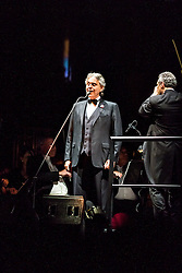 ANAHEIM, CA - JUN 9: Italian tenor Andre Bocelli performed Granada, New York, La Boheme, LaTraviata among others keeping audience mesmerized at the Honda Center in Anaheim, CA. The magical night included producer David Foster on Piano, Violinist Caroline Cambell, American Idol Season 3 winner Soul Singer Fantasia, Cuban Soprano Maria Aleida and Orchestra Conductor Eugene Kohn. On the left conductor Eugene Kohn. All fees must be ageed prior to publication, Byline and/or web usage link must  read  PHOTO: SilvexPhoto.com