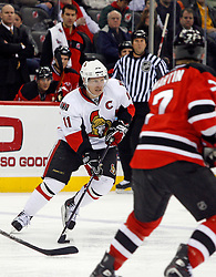 February 13, 2008; Newark, NJ, USA;  Ottawa Senators right wing Daniel Alfredsson (11) carries the puck during the third period at the Prudential Center in Newark, NJ. The New Jersey Devils beat the Ottawa Senators 3-2 on an overtime goal by New Jersey Devils right wing Brian Gionta (14).