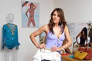 Elizabeth Hurley with her swimwear designs in her studio in South Kensington, London, UK. Sold exclusively in Harrods and Saks in New York. .