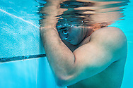 2016/06/04 &ndash; Bogotá, Colombia: Moises Fuentes Garcia, 41, takes a break during a training session at the Simon Bolivar Aquatic Complex, Bogotá, 4th June, 2016.<br />  -<br /> Moises used to be a farmer and sell cattle with his brother when in October 1992, Paramilitaries in the region of Santa Marta targeted them. Moises was shot six times, and his brother killed. He was &ldquo;lucky&rdquo; to survive, one of the bullets crossed his neck, and one stuck into his spine and he couldn&rsquo;t walk again. However it did not end there, a few months later, during a rehabilitation session he broke his leg and due to an infection he had to amputate it. Moises felt it wasn&rsquo;t worth living anymore. But after meeting a group of other victims that had even more severe injures, he grabbed life with will and began to feel motivated. He started playing wheelchair basketball and studying. In the process of the rehabilitation he was spotted as a good swimmer, even if he didn&rsquo;t possess any technique. After some success on the swimming pool, he became completely dedicated to the sport, while finishing degrees as a tailor, public accountant and hopes to graduate as a sport teacher next year. <br /> Among many achievements he won the Bronze medal in 2008 Paralympic Games in Beijing and Silver medal on the 2012 Paralympic Games in London on the 100 meters breaststroke category. He also became the World Champion at the 2013 World Swimming Championships. Moises hopes that in the Rio 2016 Paralympics, he will bring gold home. <br /> He believes that people must value their life, what they have and help people on the way. &ldquo;Everyone is a champion, but some people don&rsquo;t do the necessary to really became one&rdquo; he says. (Eduardo Leal)
