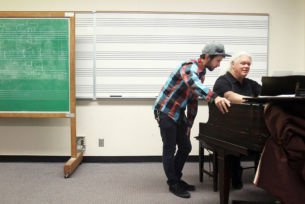 To grade his music students' finals, Marshall Tuttle plays their compositions in front of them on Monday, Dec. 12, 2011. No pressure! Here, Matt Berg is judged at Mt. Hood Community College in Gresham.