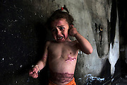 """Palestinian three year-old Farah Abu Halima   in one of the many burnt rooms in the Abu Halima home in the a-Sifa section of Beith Layiha, Gaza April 23,2009. Farah's mother Ghada died of her wounds in an Egyptian hosptal on March 29,2009. Farah sustained severe burns and was evacuated to Egypt for emergency medical together with her mother when the Abu Halima home was shelled on January 4,2009 during the Israeli military invasion into the Gaza Strip code named """"Operation Cast Lead"""" . Five of the Abu Halima family members were burned to death ..Fahar's mother gave her testimony to B'Tselem, the Israeli Information Center for Human Rights in the Occupied Territories. In her testimony she described how she was holding her daughter Farah when her whole body caught on fire .She described in her testimony that she had taken all of her clothes off and still her body continued to burn .(Photo by Heidi Levine/Sipa Press)...."""