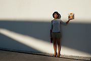 The young artist Annie Alvarez Lastra in front of the modern Museo de Arte Contemporaneo de Tamaulipas. <br /> <br /> Matamoros, Tamaulipas, Mexico.<br /> <br /> &copy; Stefan Falke<br /> www.stefanfalke.com<br /> La Frontera: Artists along the US Mexican Border