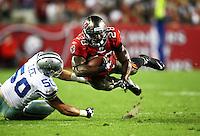 Dec 17, 2011;  Tampa, FL, USA; Tampa Bay Buccaneers running back Kregg Lumpkin (28) is tripped up by Dallas Cowboys inside linebacker Sean Lee (50) during the third quarter at Raymond James Stadium.