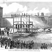 Execution of the Lincoln conspirators by hanging, Condemned to die on the gallows: Mrs. Surratt, Payne, Harold and Atzerott. From a photo by Gardner Harper's Weekly, Sat July 22, 1865